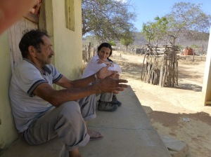 Claudia speaks with a local who is worried about illegal logging of trees, just outside of Boqueirão da Onça.
